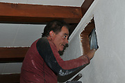 There are times when you can solve a problem through a hole in the wall. Here's heating and cooling wizard Jon Feldman adding one to my living room. It's for the return side of my HVAC air duct system.