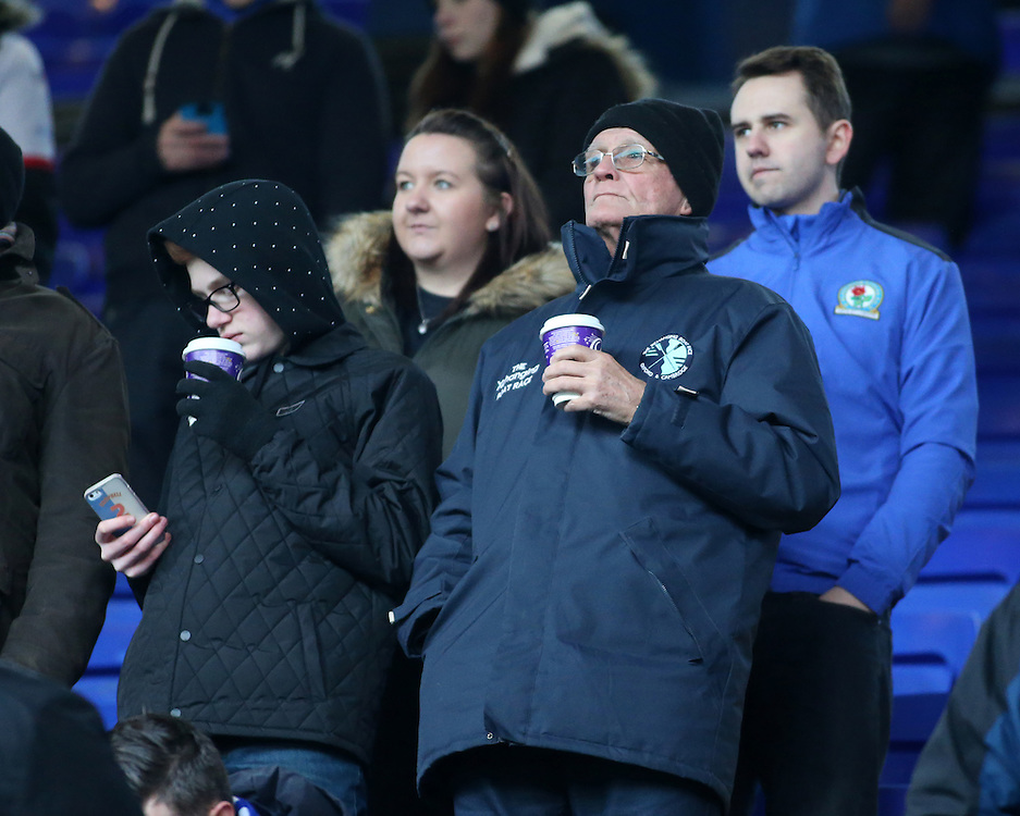 Blackburn Rovers fans try to keep warm during the game<br /> <br /> Photographer David Shipman/CameraSport<br /> <br /> The EFL Sky Bet Championship - Ipswich Town v Blackburn Rovers - Saturday 14th January 2017 - Portman Road - Ipswich<br /> <br /> World Copyright © 2017 CameraSport. All rights reserved. 43 Linden Ave. Countesthorpe. Leicester. England. LE8 5PG - Tel: +44 (0) 116 277 4147 - admin@camerasport.com - www.camerasport.com