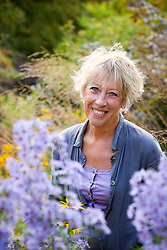 Carol Klein with asters in the foreground
