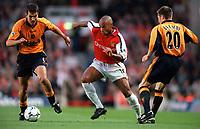 Thierry Henry (Arsenal) Nick Barmby and Markus Babbel (Liverpool). Arsenal 2:0 Liverpool, F.A.Carling Premiership, 21/8/2000. Credit : Colorsport / Stuart MacFarlane.