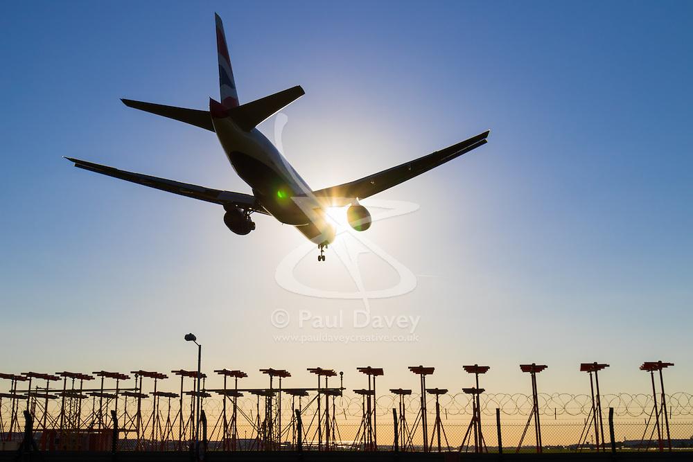 A British Airways Boeing 777 lands on Runway 27R at London's Heathrow Airport (LHR / EGLL).