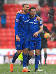 Everton's Cenk Tosun (left) and Everton's Leighton Baines celebrate after the final whistle during the Premier League match at the bet365 Stadium, Stoke.