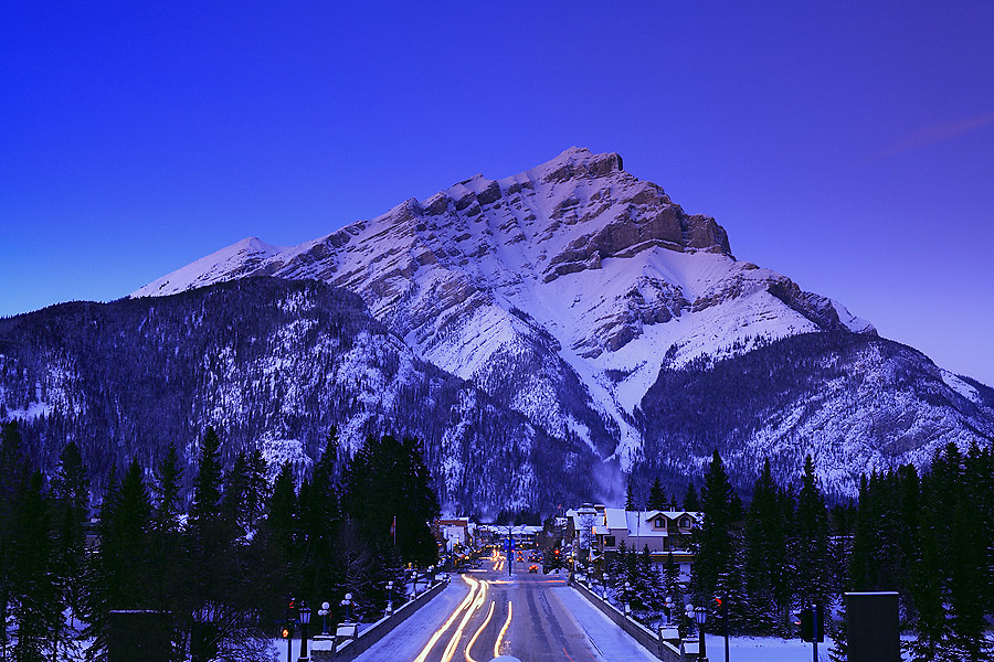 Cascade Mountain and Banff Avenue in winter at dusk, Town of Banff, Banff National Park, Alberta, Canada