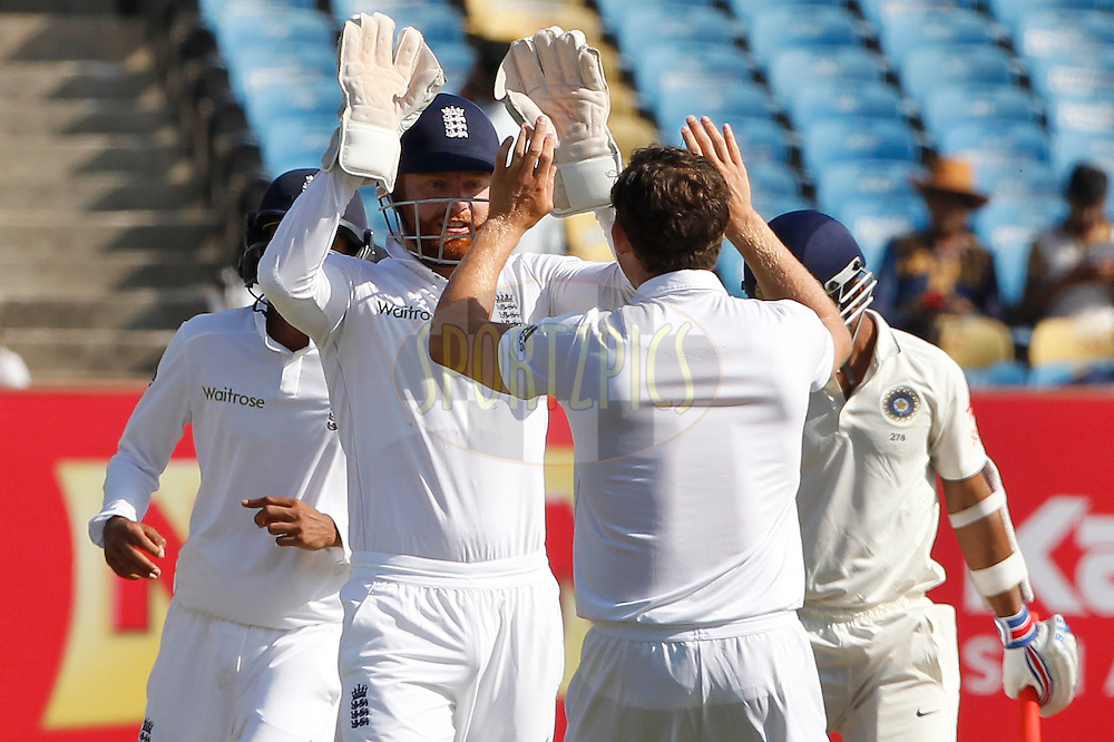 Jonny Bairstow of England and Zafar Ansari of England celebrates the wicket of Ajinkya Rahane of India during day 4 of the first test match between India and England held at the Saurashtra Cricket Association Stadium , Rajkot on the 12th November 2016.<br /> <br /> Photo by: Deepak Malik/ BCCI/ SPORTZPICS