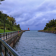 """""""Walkway to Charlevoix Lighthouse"""" <br /> <br /> Take a look and a walk down the path to the South Pier Lighthouse in Charlevoix Michigan!"""