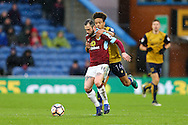 Steven Defour of Burnley is held back by Bobby Reid of Bristol City. The Emirates FA cup 4th round match, Burnley v Bristol City at Turf Moor in Burnley, Lancs on Saturday 28th January 2017.<br /> pic by Chris Stading, Andrew Orchard Sports Photography.