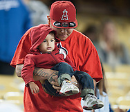 Fans stay warm during the Angels' Freeway Series game against the Dodgers Thursday night at Dodger Stadium.<br /> <br /> ///ADDITIONAL INFO:   <br /> <br /> freeway.0401.kjs  ---  Photo by KEVIN SULLIVAN / Orange County Register  --  3/31/16<br /> <br /> The Los Angeles Angels take on the Los Angeles Dodgers at Dodger Stadium during the Freeway Series Thursday.<br /> <br /> <br />  3/31/16