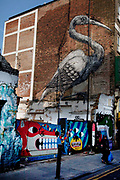 Roa is a Belgian street artist renowned for his giant black and white animals which can be found on walls and shutters in varying states of decay. Biggest of them all is the Roa Crane on Hanbury Street which was put up in 2010. There are also a few Rats and Birds which reside on shop shutters along Brick Lane.<br /> <br /> Street art in the East End of London is an ever changing visual enigma, as the artworks constantly change, as councils clean some walls or new works go up in place of others. While some consider this vandalism or graffiti, these artworks are very popular among local people and visitors alike, as a sense of poignancy remains in the work, many of which have subtle messages.
