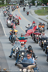 A parade of motorcycles riding from Laconia arrive in Meredith for the Northeast POW/MIA Network's Freedom Ride and vigil to raise awareness of POW/MIA issues during Laconia Motorcycle Week, New Hampshire, USA. Thursday June 15, 2017. Photography ©2017 Michael Lichter.