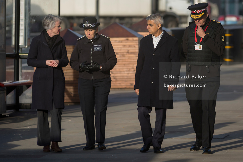 The morning after the terrorist attack at Fishmongers Hall on London Bridge, in which Usman Khan (a convicted, freed terrorist) killed 2 during a knife a attack, then subsequently tackled by passers-by and shot by armed police - Met Police Cressida Dick (second left), London Mayor Sadiq Khan and City of London Commissioner Ian Dyson leave the crime scene, on 30th November 2019, in London, England.