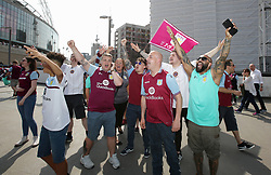 Aston Villa fans during the Sky Bet Championship Final at Wembley Stadium, London.