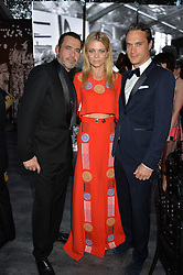 Left to right, ROLAND MOURET and The MARQUESS & MARCHIONESS OF DOURO at British Vogue's Centenary Gala Dinner in Kensington Gardens, London on 23rd May 2016.