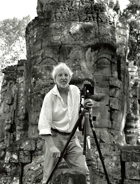 Photographer John McDermott working in Angkor