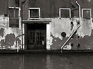 The wall of a small house on Rio della Sensa, a canal in the Sestiere of Cannaregio in Venice, Italy