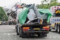 © Licensed to London News Pictures. 26/08/2017. Milton Keynes, UK. Remains of the minibus (front) and a lorry (rear) involved in the crash, are removed from the M1 motorway near Milton Keynes. Police say that several people are dead and four others have been taken to hospital after the accident on the southbound carriageway in the early hours of this morning. Photo credit: Ben Cawthra/LNP