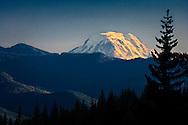 Mount Adams rises above the ridges as seen from the Cowlitz River Canyon on Mount Rainier, Washington, USA
