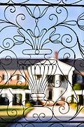 Wrought iron decorative gates at the Colonial Revival plantation house at Boone Hall Plantation in Mt Pleasant, South Carolina.