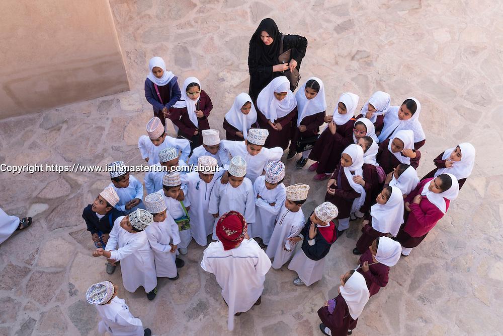 Omani school children visiting Nizwa Fort in Oman