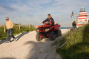 A life guard on South Beach Miami taking his dune buggey back to its garage after work