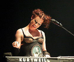 Amanda Palmer<br /> performing live at The Roundhouse, London, Great Britain <br /> 13th July 2013 <br /> with the Grand Theft Orchestra <br /> <br /> Jherek Bischoff (bass, backing vocals), Chad Raines (lead guitar, banjo, backing vocals, horn arrangements, programming).<br /> Thor Harris on drums <br /> <br /> <br /> Amanda Palmer <br /> <br /> <br /> Amanda MacKinnon Gaiman Palmer, sometimes known as Amanda Fucking Palmer, is an American performer who first rose to prominence as the lead singer, pianist, and lyricist/composer of the duo The Dresden Dolls<br /> <br /> Photograph by Elliott Franks and Ignius Pupinis