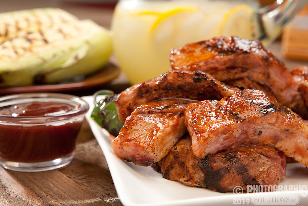 Bar-b-qued ribs with a side of bbq sauce