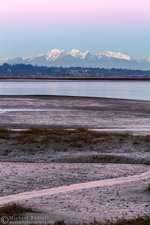 Mount Blandshard (The Golden Ears) and Mount Robbie Reid from the banks of the Nicomeckl River. Photographed from Crescent Beach's Blackie Spit in Surrey, British Columbia, Canada