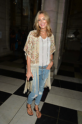 KIM HERSOV at a private view of 'Horst: Photographer of Style' at The V&A Museum, London on 3rd September 2014.