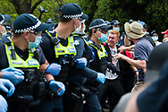 A man is seen being grabbed by police during the Melbourne Freedom Rally at The Shrine. Premier Daniel Andrews promises 'significant' easing of Stage 4 restrictions this weekend. This comes as only one new case of Coronavirus was unearthed over the past 24 hour and no deaths. (Photo by Dave Hewison/Speed Media)