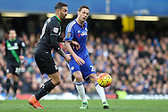 Nemanja Matic of Chelsea in action with Geoff Cameron of Stoke City intercepting. Barclays Premier league match, Chelsea v Stoke city at Stamford Bridge in London on Saturday 5th March 2016.<br /> pic by John Patrick Fletcher, Andrew Orchard sports photography.