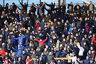 Wolves fans celebrate their teams late equaliser during the The FA Cup fourth round match between Shrewsbury Town and Wolverhampton Wanderers at Greenhous Meadow, Shrewsbury, England on 26 January 2019.