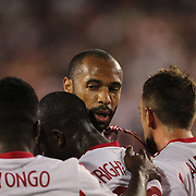 Thierry Henry congratulates Bradley Wright-Phillips, New York Red Bulls, after scoring from the penalty spot during the New York Red Bulls Vs Seattle Sounders, Major League Soccer regular season match at Red Bull Arena, Harrison, New Jersey. USA. 20th September 2014. Photo Tim Clayton