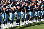 Tennessee Titans players stand on the sideline during the playing of the Star Spangled Banner during pregame festivities before the 2017 NFL week 9 regular season football game against the Baltimore Ravens, Sunday, Nov. 5, 2017 in Nashville, Tenn. The Titans won the game 23-20. (©Paul Anthony Spinelli)