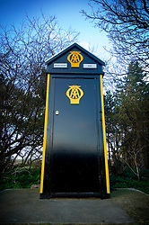 """Traditional old style AA (Automobile Association) wooden sentry box, also known as """"lighthouse of the road"""", Brancaster Staithe, North Norfolk Coast, England, UK."""