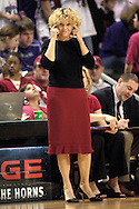 Oklahoma head coach Sherri Coale tell her Sooners to think, after turning the ball over to Kansas State during the second half at Bramlage Coliseum in Manhattan, Kansas, February 21, 2006.  The 9th ranked Sooners defeated K-State 78-64.