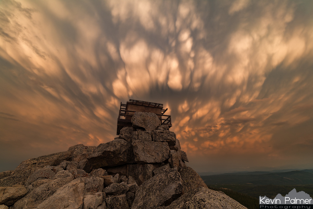 When the lightning rod at the top of Black Mountain started buzzing, I knew I had to descend to escape the lightning danger. But I'm glad I returned afterwards, because the  sunset was incredible. Mammatus filled the sky as the storm cleared and it took on an orange color as the sun lowered. All the smoke in the air added to the surreal atmosphere. The fire lookout structure was recently closed to the public because it's fallen into disrepair.