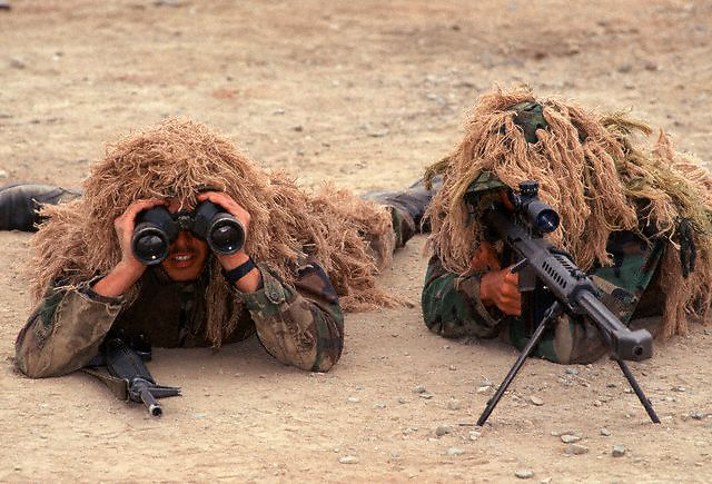 """1994, California, USA --- A United State Marine Corps sniper team trains with 50 caliber sniper rifles.  These men serve at part of the Marine Corps """"land"""" fighting component of the United States Navy. --- Image by © Leif Skoogfors"""