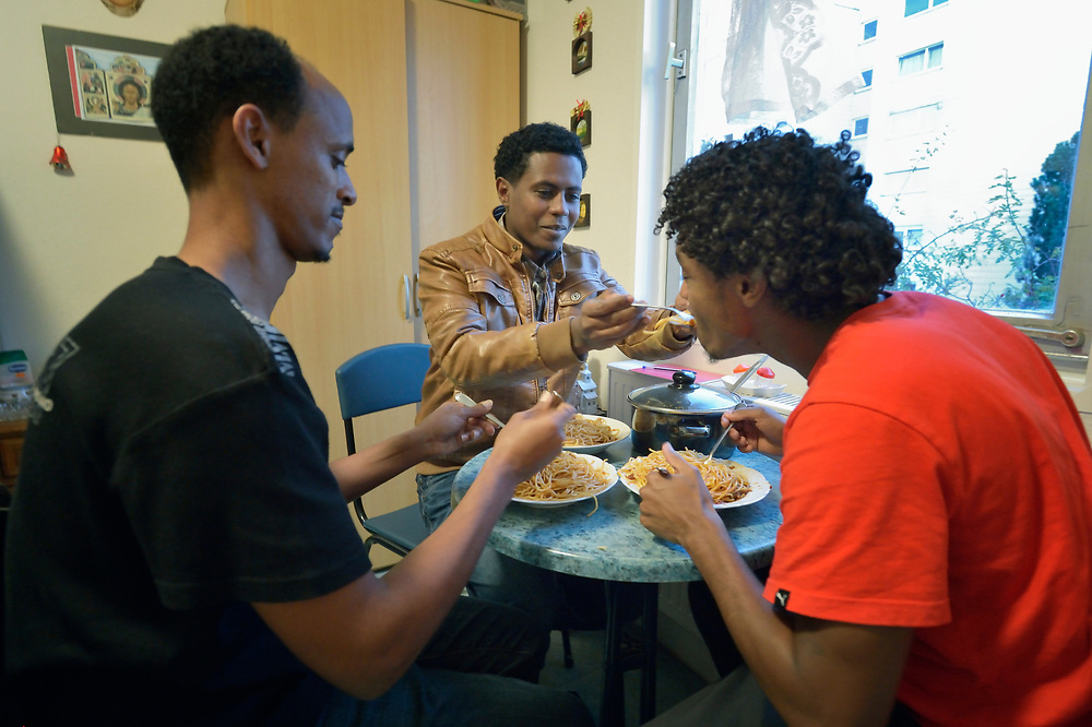 Eritrean asylum seekers share a meal in their room in a church-run shelter in Freudenstadt, Germany. The Freundesdreis Asyl is run by Christlicher Kirchen, and managed by a retired United Methodist pastor. The shelter has 18 asylum seekers from Eritrea and 10 from Gambia. They came to Europe via Sudan and Libya, crossing the Mediterranean to Italy.
