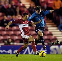 Photo: Jed Wee.<br />Middlesbrough v Dnipro. UEFA Cup. 03/11/2005.<br /><br />Middlesbrough's Doriva (L) and Dnipro's Olexandr Melashchenko challenge for possession.