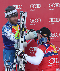 KITZBUHEL AUSTRIA. 22-01-2011. Bode Miller (USA) 2nd congratulates Didier Cuche (SUI) winner at the presentation ceremony for the 71st Hahnenkamm downhill race part of  Audi FIS World Cup races in Kitzbuhel Austria.  Mandatory credit: Mitchell Gunn