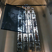 Large format transparent print installation of Garmsir Marines images in Amsterdam, Netherlands.