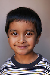 Portrait of a young boy smiling,