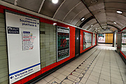 April 8, 2020, London, England, United Kingdom: A sign in Green Park underground station shows amendments in a red pen which stations have been closed in an attempt to reduce the spread of coronavirus in London, Wednesday, April 8, 2020. (Credit Image: © Vedat Xhymshiti/ZUMA Wire)