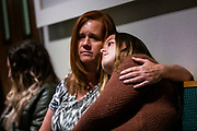 PARADISE, CA - NOVEMBER 08: Shanna Plourd of Paradise, California shares a moment with her thirteen-year old daughter, Tiffany, during the Paradise Commemoration Ceremony at the Paradise Alliance Church, on November 8, 2019 in Paradise, California. It has been one year since the Camp Fire, caused by PG&E transmission lines, tore through the town of Paradise, California, killing 85 people and destroying more than 18,000 homes and businesses, becoming the deadliest and most destructive fire in the history of California. (Photo by Philip Pacheco/Getty Images)