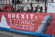 Anti Brexit, anti Tory Titanic banner in Westminster on 14th April 2021 in London, United Kingdom. The banners have been put up outside Parliament by the anti-Brexit protesters and is against Conservative Party policy, and specifically now due to the Greensill lobbying scandal.