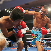 ORLANDO, FL - OCTOBER 04: Christopher Diaz of Puerto Rico (R)  catches Francisco Camacho of Mexico with a right hand during a professional featherweight boxing match at the Bahía Shriners Auditorium & Events Center on October 4, 2014 in Orlando, Florida. (Photo by Alex Menendez/Getty Images) *** Local Caption *** Christopher Diaz; Francisco Camacho