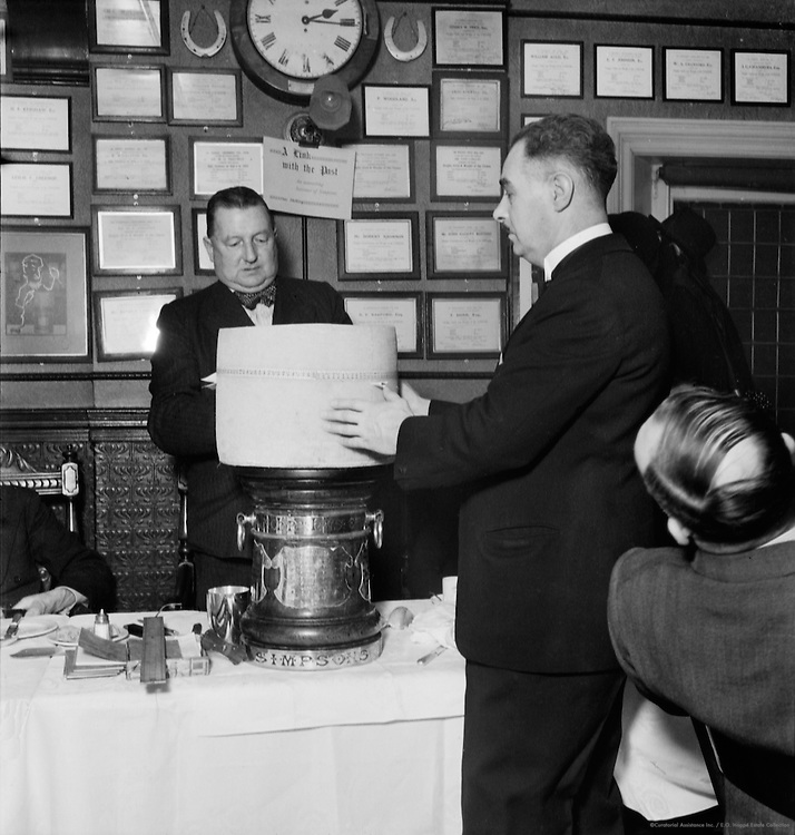 Measuring Girth of Cheese at Simpson's, Cheapside, London, 1937
