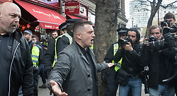 London, April 1st 2017. Former EDL leader Tommy Robinson - also known as Stephen Yaxley Lennon - remonstrates with photographers who he accuses of working with the left wing press as protesters from nationalist and anti-Islamic group Britain First demonstrate in London following the Westminster terror attack of March 22nd.