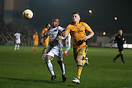 Mauro Vilhete of Barnet (l)  is challenged by Rhys Healey of Newport county ®.EFL Skybet football league two match, Newport county v Barnet at Rodney Parade in Newport, South Wales on Tuesday 25th October 2016.<br /> pic by Andrew Orchard, Andrew Orchard sports photography.