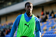 AFC Wimbledon defender Paul Osew (37) warming up as sub during the EFL Sky Bet League 1 match between AFC Wimbledon and Hull City at Plough Lane, London, United Kingdom on 27 February 2021.