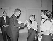 8609-A20. John F. Kennedy clicks a coed's pen to autograph her copy of his book Profiles In Courage at his lecture in the Portland State College auditorium, (Now Portland State University) May 19, 1958.